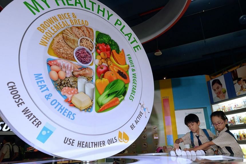 """The Health Promotion Board's """"My Healthy Plate"""" guideline aims to raise awareness about healthy eating among consumers and hawkers."""