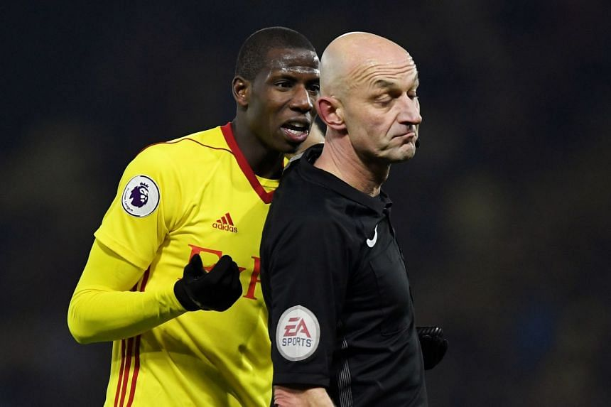 Watford's Abdoulaye Doucoure appeals to referee Roger East.