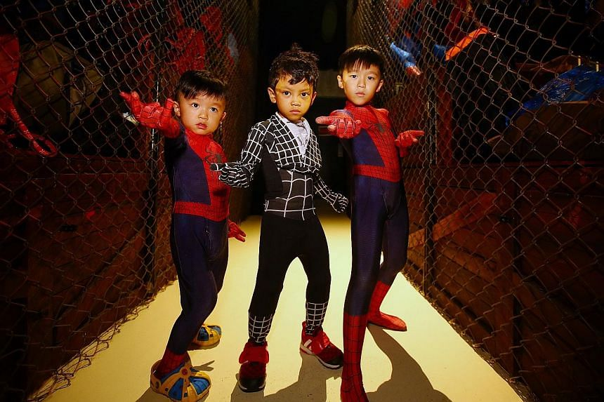 """It was an amazing fantasy for """"Spider-Boys"""" Azel Mohamed Zuraidi, four, (centre) and brothers Louie Teo (left), four, and Leroy Teo, eight, at Madame Tussauds Singapore, as they got to be the famed superhero for a day. The three boys were part of an"""