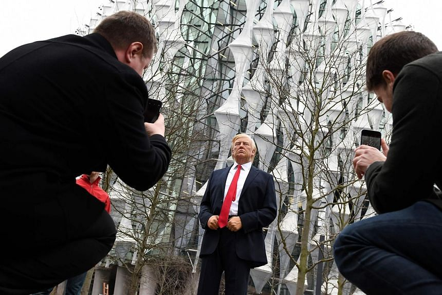 A Madame Tussauds wax figure of US President Donald Trump outside the new US Embassy in south-west London.