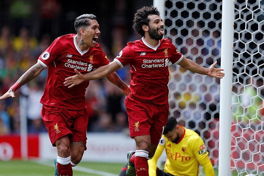 Liverpool's Mohamed Salah (right) and Roberto Firmino, together with Sadio Mane (not pictured), will need to step up for the Reds' attack today if they hope to end Manchester City's unbeaten streak in the Premier League.