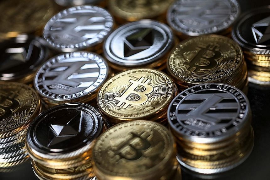 """A collection of bitcoin, litecoin and ethereum tokens. """"(Cryptocurrency) is not a legal medium of exchange,"""" says Jakarta."""