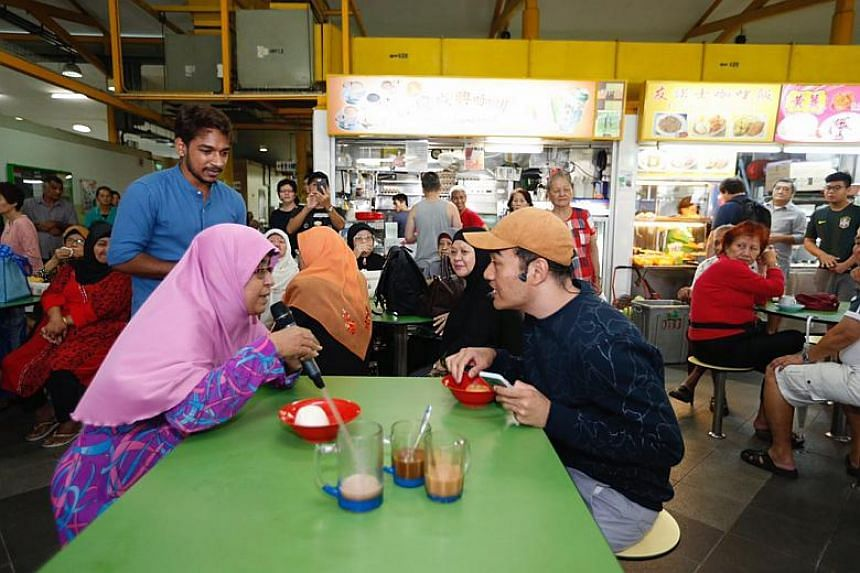 Eunos Crescent resident, Madam Rahila Ahmed, 54, intervening during the interactive theatre play, Living The Norm Way, at Eunos Crescent Market and Food Centre on Jan 14, 2018.