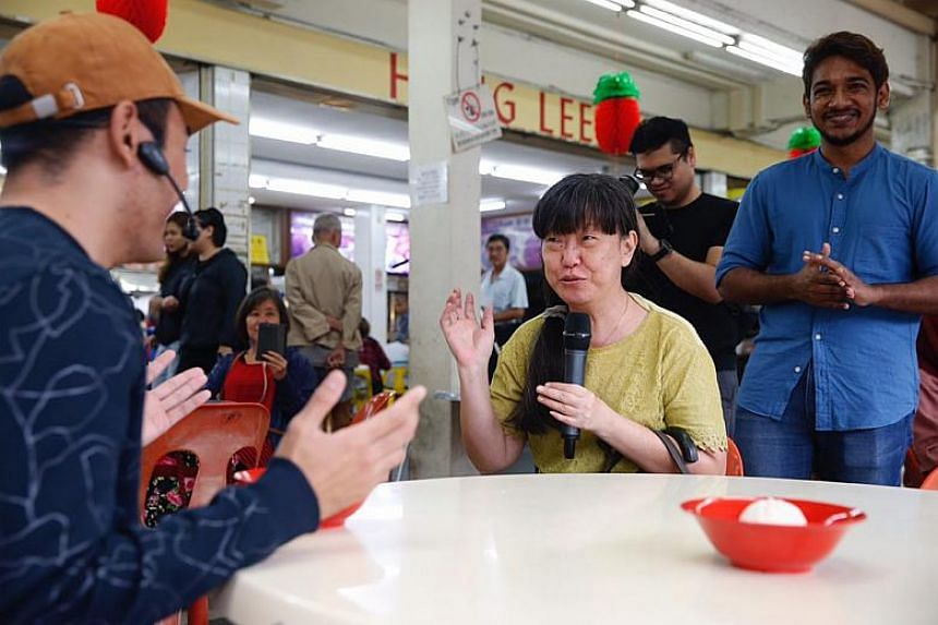 Eunos Crescent resident, Ms May, 50, interacting with one of the actors and recommending different courses of actions that could help promote kindness.