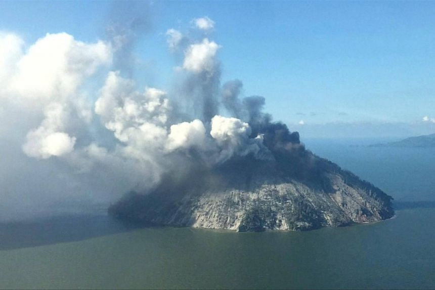 The remote island volcano of Kadovar spews ash into the sky in Papua New Guinea, on Jan 6, 2018.
