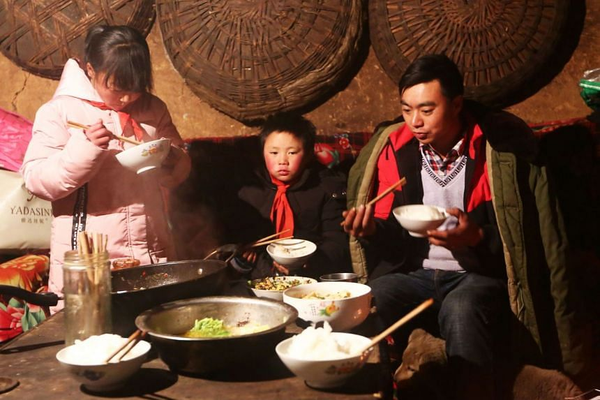 Wang Fuma with his family in Ludian in China's southwestern Yunnan province.