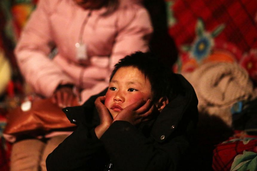 The frosty photo of Fuman (above) shined a light on the plight of the tens of millions of left-behind children who grow up in impoverished rural areas largely on their own after their parents leave to work in big cities.
