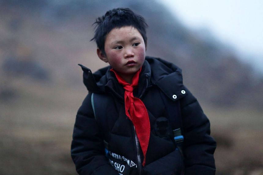 """Wang Fuman, also known as """"Frost Boy"""", is pictured in Ludian in China's southwestern Yunnan province."""