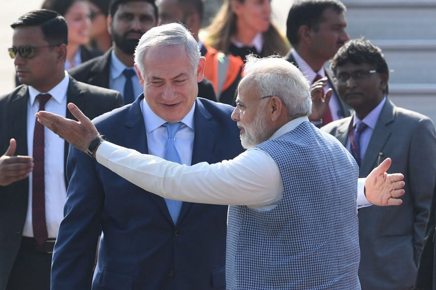 Indian Prime Minister Narendra Modi (right) welcoming his Israeli counterpart Benjamin Netanyahu at the Air Force Station in New Delhi on Jan 14, 2018.
