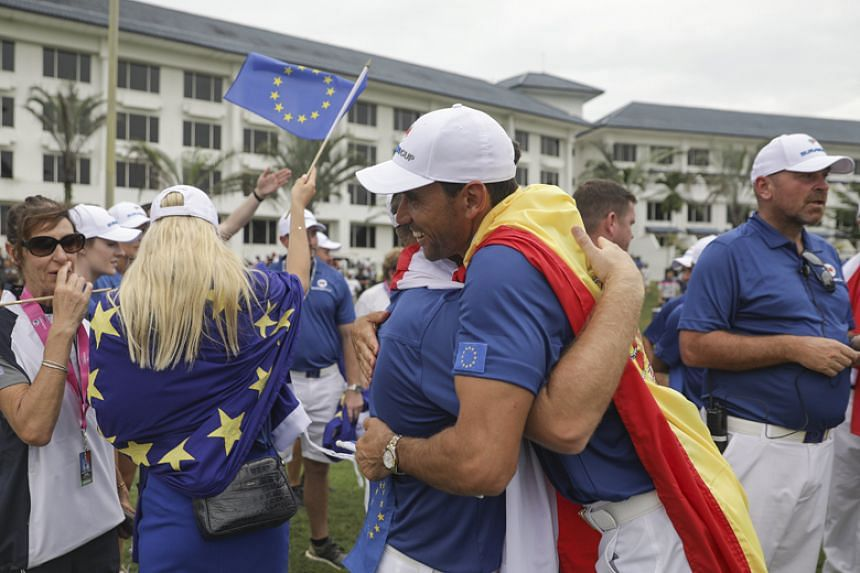 Team Europe celebrate after winning the EurAsia Cup golf tournament in Glenmarie, Malaysia, on Jan 14.
