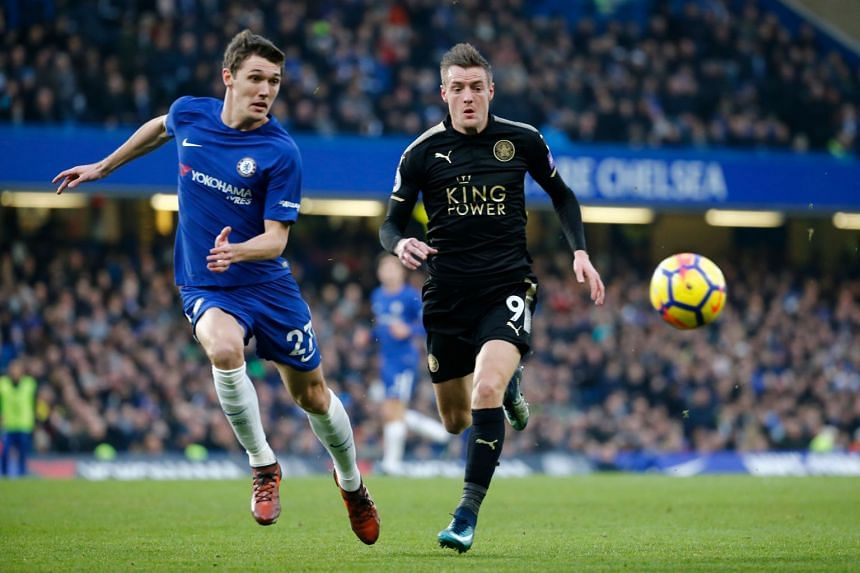 Chelsea's Andreas Christensen (left) and Leicester's Jamie Vardy chase the ball.