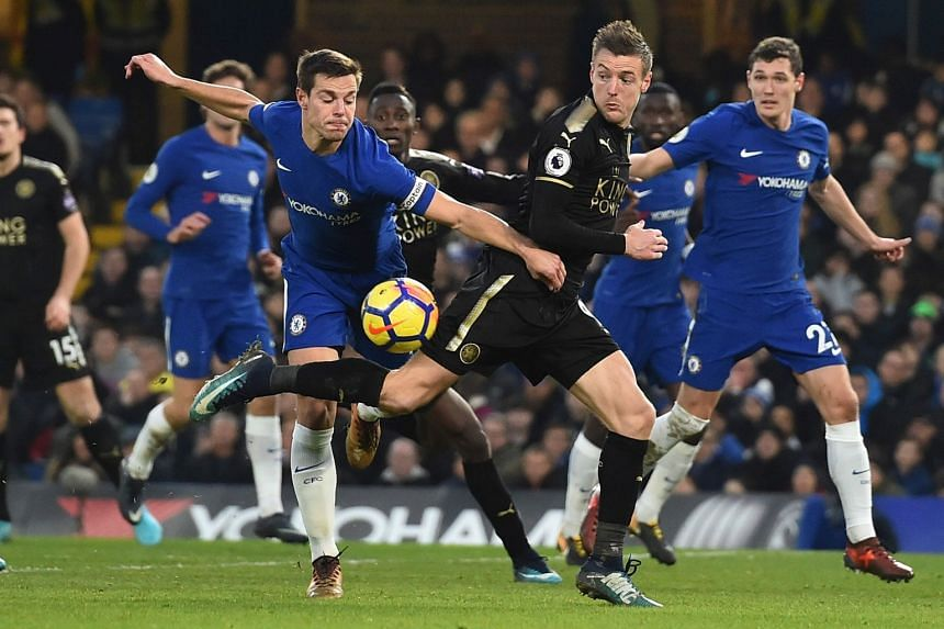 Chelsea's Spanish defender Cesar Azpilicueta (left) challenges Leicester City's English striker Jamie Vardy.