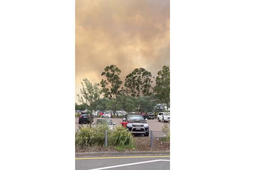 Smoke spreads during a bush fire at Newcastle Airport, New South Wales, Australia, on Jan 13.