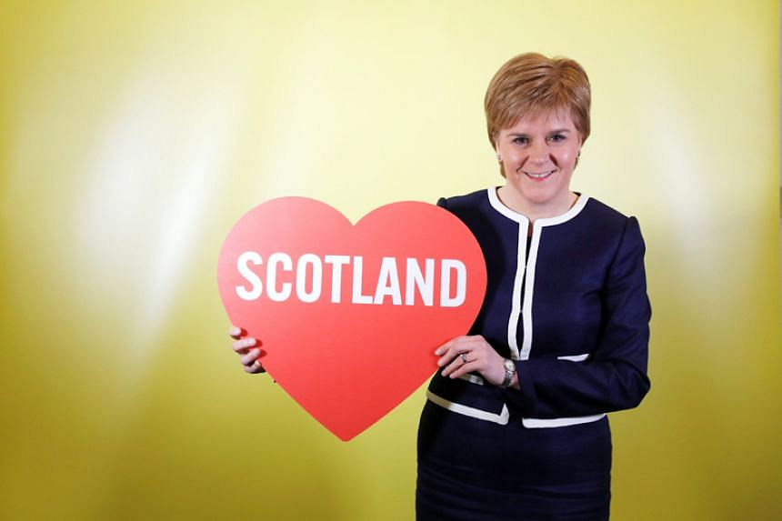 Nicola Sturgeon, leader of the Scottish National Party, poses for a photo on the sidelines of her party's conference in Aberdeen on March 17, 2017.