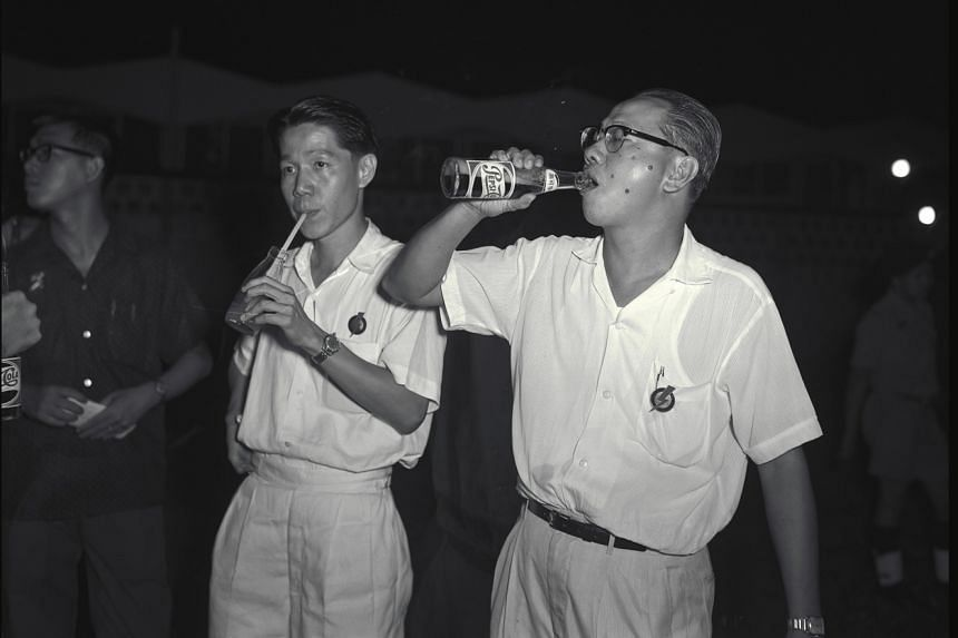 Leaders Jek Yeun Thong (left) and Lim Kim San in 1963. The PAP won a resounding victory in independent Singapore's first elections.