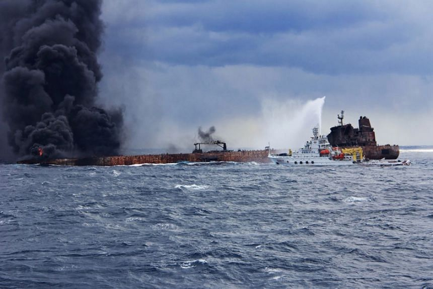 A Chinese firefighting vessel sprays foam on the burning Iranian oil tanker Sanchi off the coast of eastern China on Jan 12.