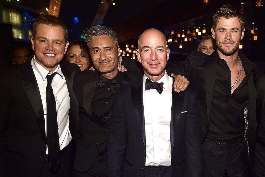 Amazon founder Jeff Bezos (second from right) with (from left) actor Matt Damon, director Taika Waititi and actor Chris Hemsworth at Amazon Studios' Golden Globes Celebration in California earlier this month.