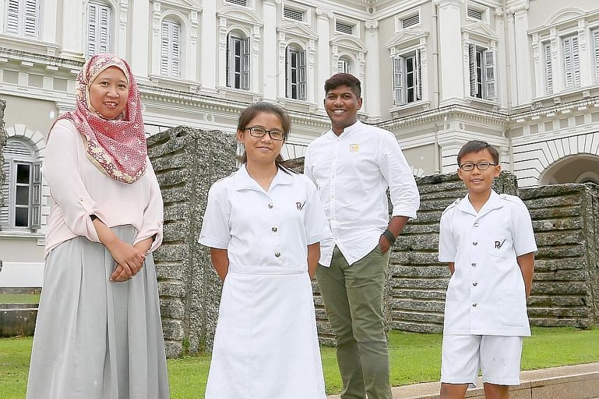 The National Heritage Board's volunteer guides include Ms Fistri Abdul Rahim, 43, who works in sales and marketing; civil servant Lionel Louis, 33; and River Valley High Schoolstudents Yong Kai Qing (second from left) and Lim Yan Zhe, both 14. There