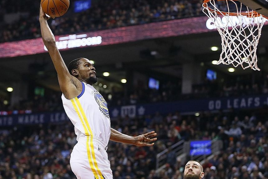 Golden State Warriors forward Kevin Durant soars for a dunk against the Toronto Raptors at the Air Canada Centre on Saturday.