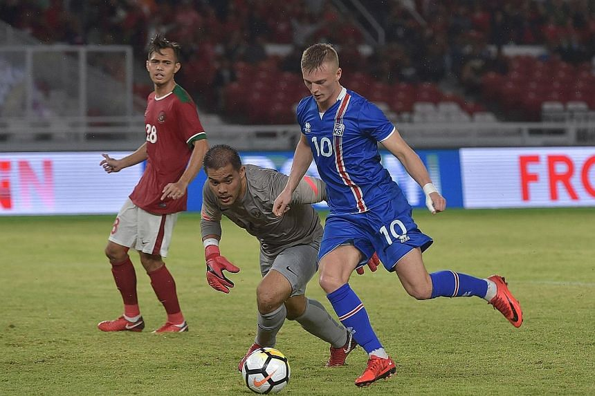Iceland midfielder Albert Gudmundsson gets past Indonesian goalkeeper Andritany Ardhiyasa in a friendly in Jakarta yesterday. Iceland won the match 4-1.