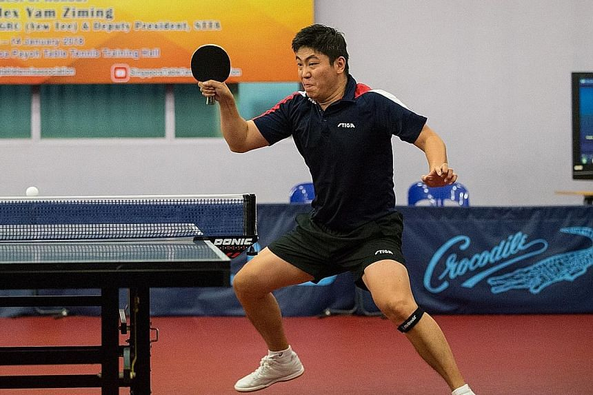 Gao Ning in action in the men's singles final of the Singapore Table Tennis Association (STTA) National Table Tennis Grand Finale yesterday at its Toa Payoh headquarters. The 35-year-old beat team-mate Ethan Poh 4-1 (14-16, 11-9, 11-6, 11-8, 11-5) to