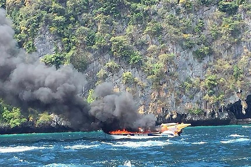 Phi Phi hospital staff said six of the 16 injured are in a serious condition. The speedboat (left) is believed to have caught fire after springing a fuel leak.