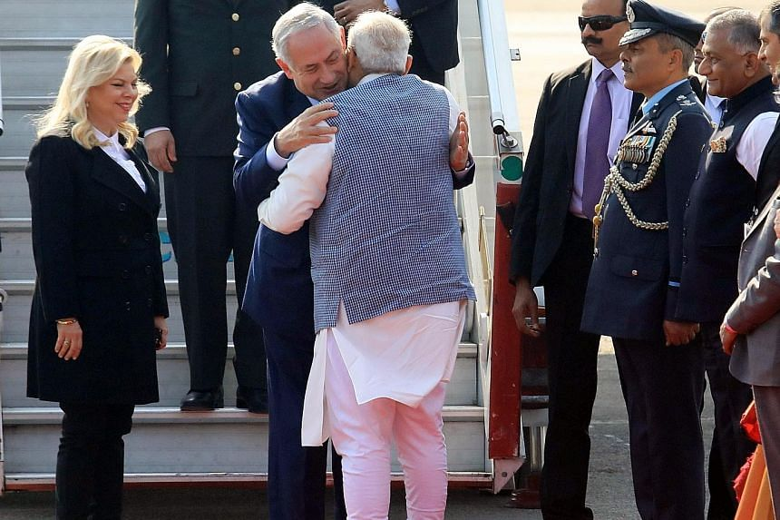 Indian PM Narendra Modi welcoming Israeli PM Benjamin Netanyahu and his wife Sarah upon their arrival at the airport in New Delhi yesterday.