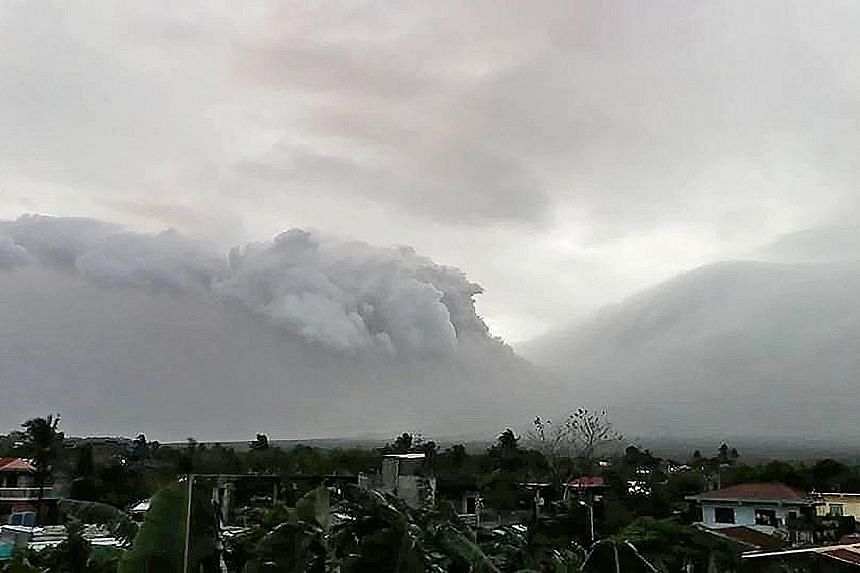 Mount Mayon erupting in Legazpi City, Philippines, on Saturday in this still obtained from social media. More than 900 families were ordered to evacuate from villages near the volcano, a tourist attraction in Albay province.