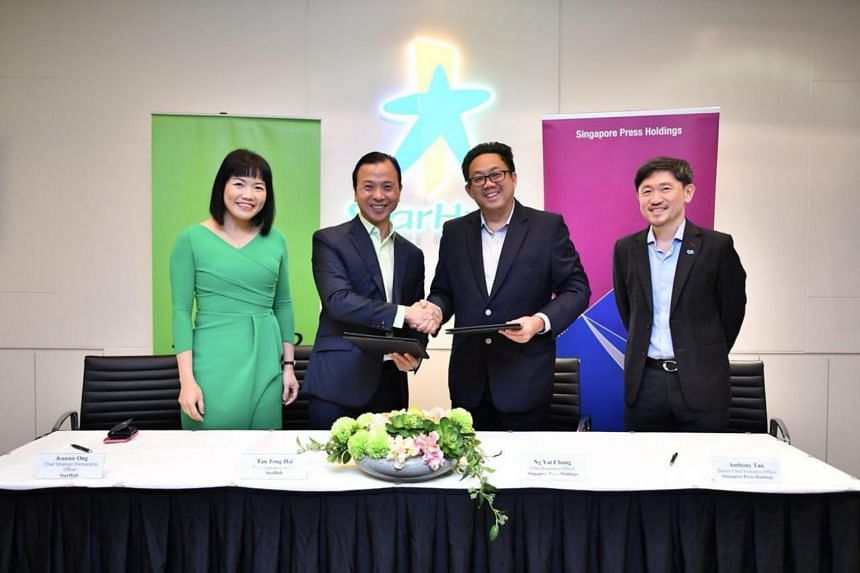 (From left) StarHub chief strategic partnership officer Jeannie Ong, StarHub chief executive Tan Tong Hai, SPH chief executive Ng Yat Chung and SPH deputy chief executive Anthony Tan after the signing of the MOU at StarHub Green on Jan 15, 2018.