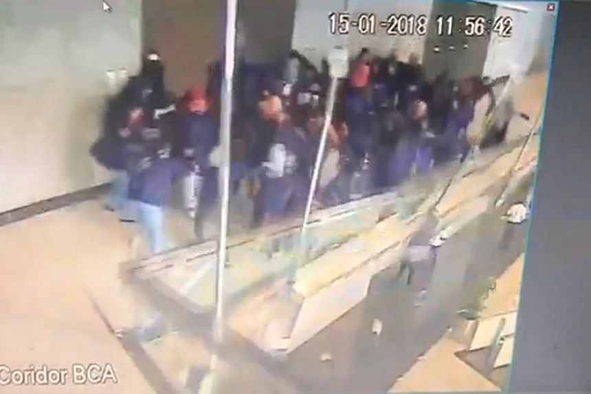A screengrab from a video which shows a group of people standing on the walkway when it collapsed.