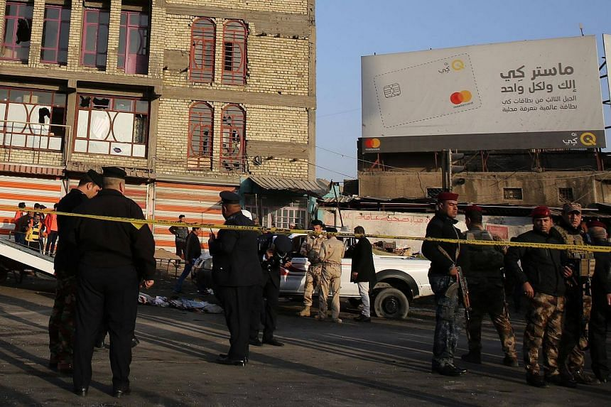 Iraqi security forces cordoning off the site of a double suicide bombing in central Baghdad on Monday (Jan 15).