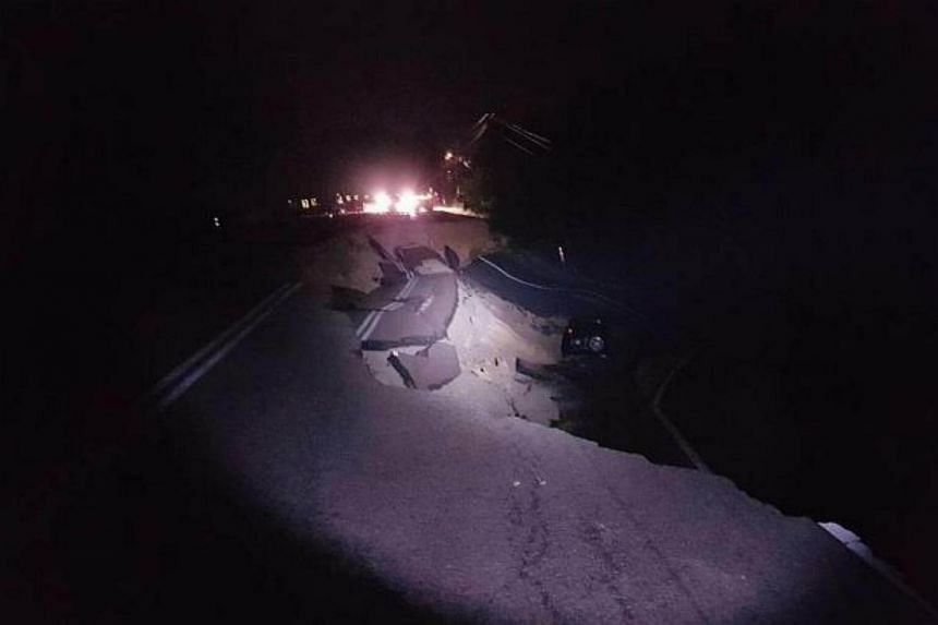 Three people escaped death when the vehicle they were travelling in skidded and plunged into a ravine near a 15m deep landslide along a road in Johor on Jan 15, 2018.