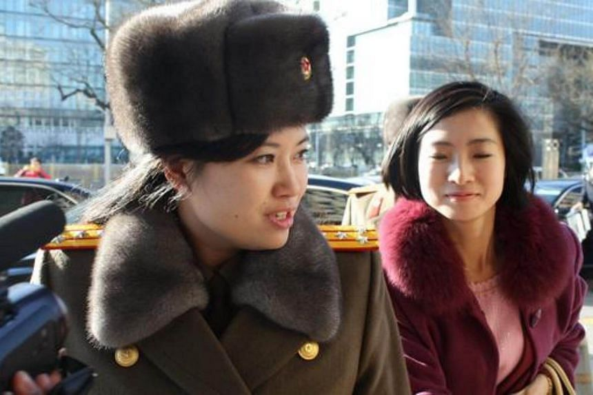 Hyon Song Wol (left), who is known as the leader of the all-female band Moranbong, has been chosen to be part of a delegation of arts officials by North Korea.