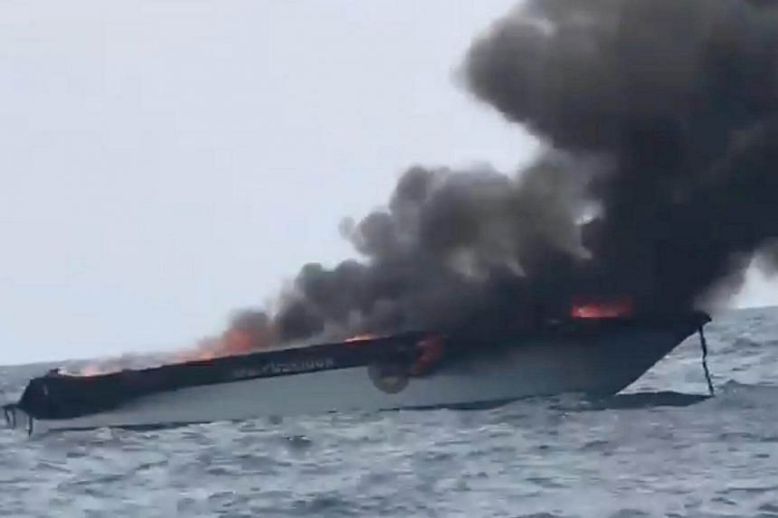 Smoke rising from the wreckage of a speeboat after it exploded near the Phi Phi Islands on Sunday (Jan 14).