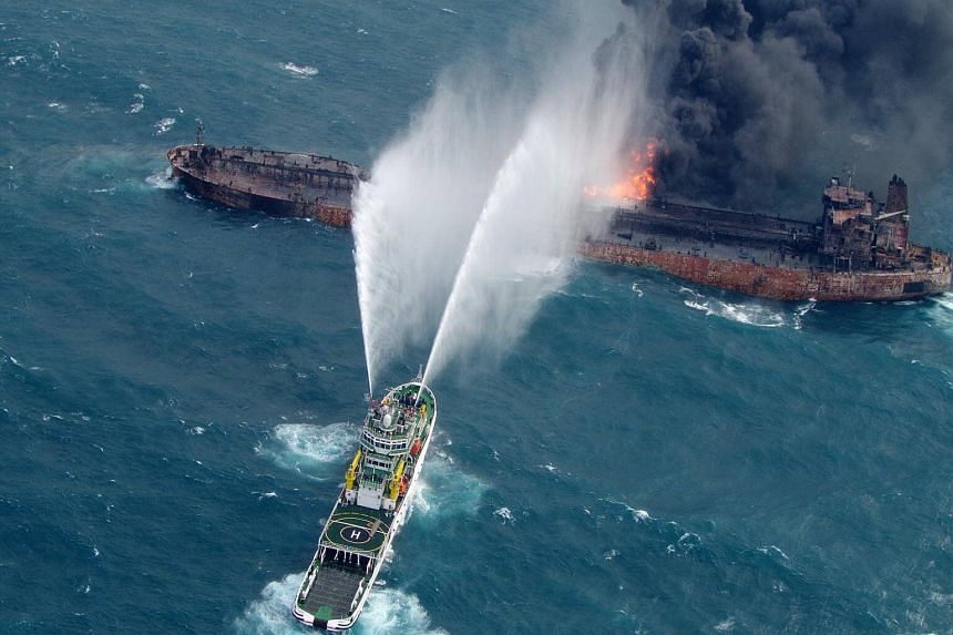 A rescue ship attempting to extinguish the fire on board the oil tanker Sanchi, off the east coast of China, on Jan 10, 2018.