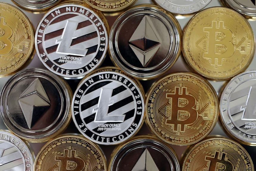 A collection of bitcoin, litecoin and ethereum tokens - just three of the more than 1,400 crypocurrencies already in existence.