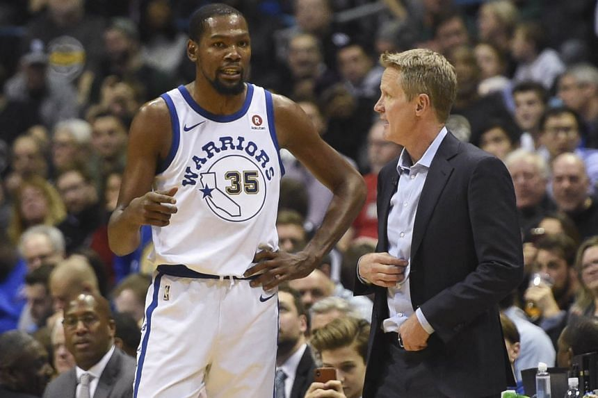 Golden State Warriors head coach Steve Kerr speaking with forward Kevin Durant during the NBA match against the Milwaukee Bucks on Jan 13, 2018.