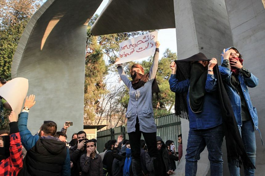 Iranian students staging an anti-government protest around the University of Teheran on Dec 30, 2017.