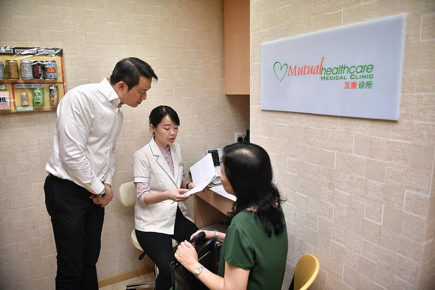 Senior Minister of State for Health Lam Pin Min observing nurse Serene Ang explaining a diabetic diet to Madam Chng Kah Sing at Mutual Healthcare Medical Clinic, on Jan 15, 2018.