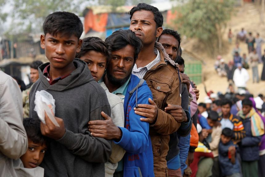 Rohingya refugees queueing up for the distribution of daily essentials at Balukhali camp, near Cox's Bazar, Bangladesh, on Monday (Jan 15).