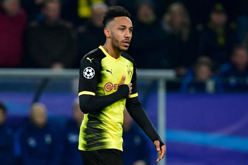 Dortmund's Gabonese forward Pierre-Emerick Aubameyang celebrating scoring the opening goal during the UEFA Champions League Group H football match BVB Borussia Dortmund v Tottenham Hotspur at the BVB Stadion in Dortmund, western Germany on Nov 21, 20