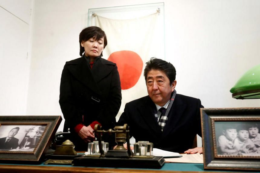 Japan's Prime Minister Shinzo Abe and his wife Akie Abe visit a former home of Chiune Sugihara, a Jew-saving Japanese diplomat, in Kaunas, Lithuania on Jan 14, 2018.