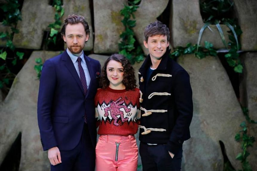 (From left) British actors Tom Hiddleston, Maisie Williams and Eddie Redmayne pose on the carpet prior to the world premiere of the film Early Man in London on Jan 14, 2018.