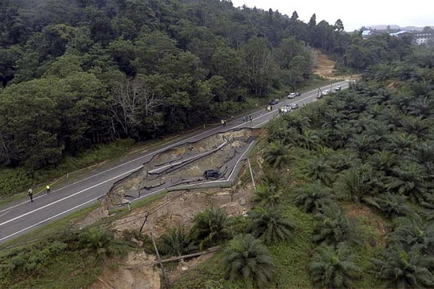 The section of the Jalan Jemaluang-Mersing road affected by the cave-in.