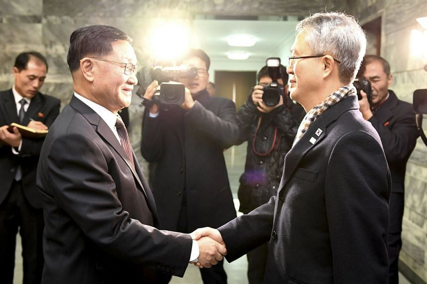 South Korean chief delegate Lee Woo Sung (right) and his North Korean counterpart Kwon Hook Bong (left) at a meeting in the truce village of Panmunjomon on Jan 15.