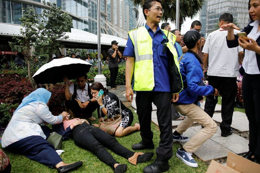 Injured people being treated outside the Indonesia Stock Exchange building after reports of a collapsed structure.