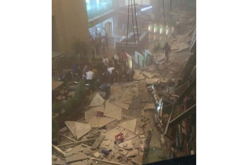 People were evacuated from the Indonesia Stock Exchange building in Jakarta after a walkway collapsed.