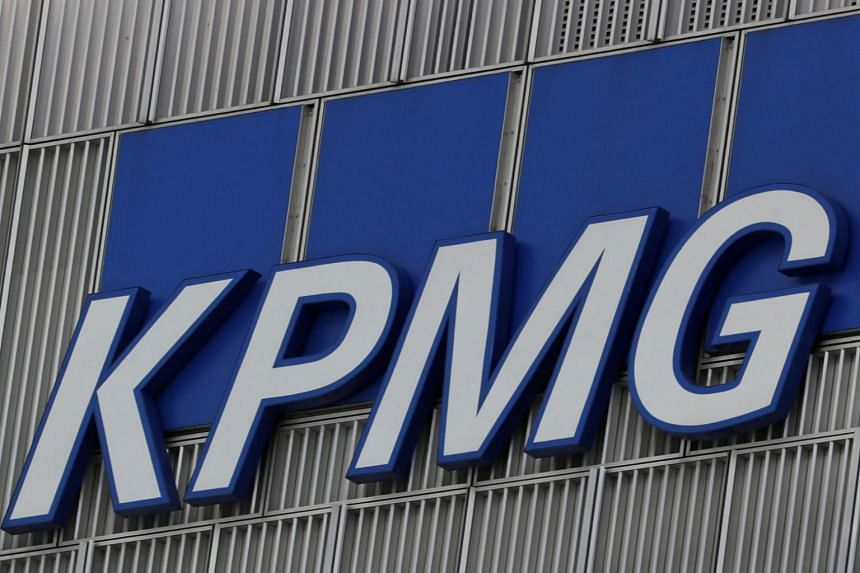 The KPMG logo seen at their offices at the Canary Wharf financial district in London.