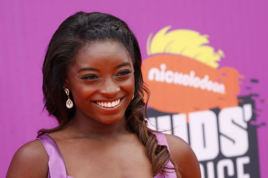 Biles (above) said she had wrestled with her decision to go public with her story since the scandal broke.