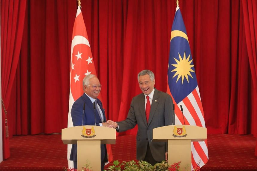 Prime Minister Lee Hsien Loong with his Malaysian counterpart Najib Razak after a joint press conference during the annual Leaders' Retreat on Jan 16, 2018.